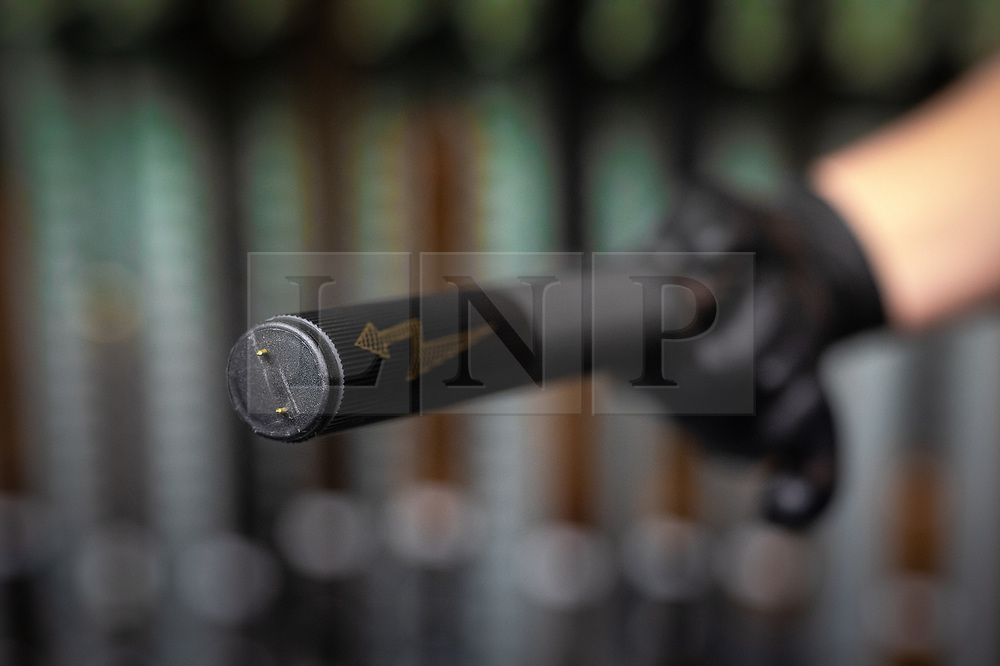 © Licensed to London News Pictures . 13/06/2019. Manchester , UK . A recovered shock baton disguised as an umbrella . Inside Greater Manchester Police's weapons store at Claytonbrook in Openshaw where police issue firearms and recovered weapons are held . Photo credit : Joel Goodman/LNP