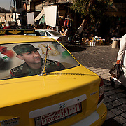 Syrian Taxi with the portrait of Bachar al-Assad on it, Damascus, Syria. Portrait du Président Syrien Bachar al-Assad sur un Taxi, Damas, Syrie.