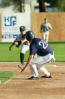 KELOWNA, BC - JULY 24:  Austen Butler #28 of the Kelowna Falcons leads off for second base against the Yakima Valley Pippins at Elks Stadium on July 24, 2019 in Kelowna, Canada. (Photo by Marissa Baecker/Shoot the Breeze)