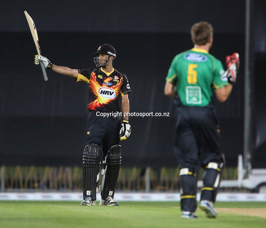 Wellington's Grant Elliott celebrates his 50 in the HRV Cup T20 cricket match between the Central Districts Stags and the Wellington Firebirds at McLean Park, Napier, New Zealand. Friday, 07 December, 2012. Photo: John Cowpland / photosport.co.nz