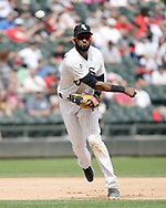 CHICAGO - AUGUST 06:  Alexei Ramirez #10 of the Chicago White Sox fields against the Texas Rangers on August 6, 2014 at U.S. Cellular Field in Chicago, Illinois.  (Photo by Ron Vesely)