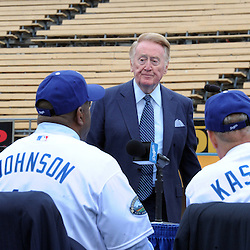 Los Angeles Dodgers broadcaster, Vin Scully, center, looks on as Dodgers, President and CEO Stan Kasten, right, Earvin &ldquo;Magic&rdquo; Johnson, center, and Mark Walter, controlling partner of the Guggenheim Baseball Management speak during a press conference announcing the new ownership of the Los Angeles Dodgers by the Guggenheim Baseball Management Group at Dodger Stadium in Los Angeles on Wednesday, May 2, 2012.<br />  (SGVN/Staff Photo by Keith Birmingham)