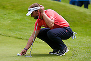 Dutch golf professional Joost Luiten marks his ball during the BMW PGA Championship at the Wentworth Club, Virginia Water, United Kingdom on 28 May 2016. Photo by Simon Davies.