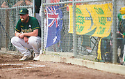 An Australian player chews gum during gold-medal game 2017 Men's World Softball Championship action on July 16.