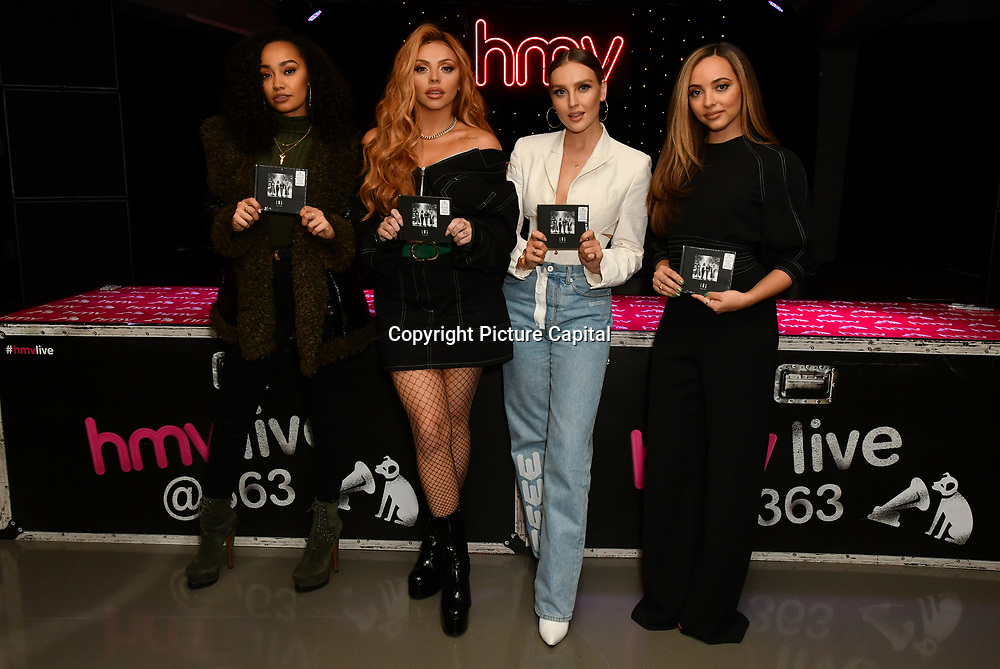 Leigh‑Anne Pinnock, Jesy Nelson, Perrie Edwards and Jade Thirlwall sign copies of their latest album 'LM5' at hmv Oxford Street on 19 November 2018, London, UK.
