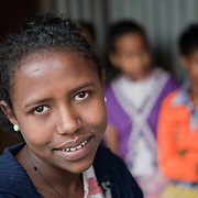 Meseret Mekonin, 18, at  Biruh Tesfa, in Addis Ababa. Biruh Tesfa means bright future in Amharic, and is a program for urban adolescent girls at risk of exploitation and abuse. For many girls, going to Biruh Tesfa is their only hope of an education and a respite from their domestic work. ..The program promotes functional literacy, life skills, livelihoods skills, and HIV/reporductive health education through girls' clubs led by adult female mentors. The girls' clubs are held in meeting spaces donated by the kebele (local administration).
