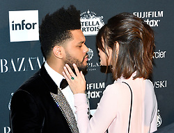 L-R: Musicians The Weeknd and Selina Gomez attend the Harper's Bazaar Icons by Carine Roitfeld celebration at The Plaza Hotel in New York, NY on September 8, 2017.  (Photo by Stephen Smith/SIPA USA)
