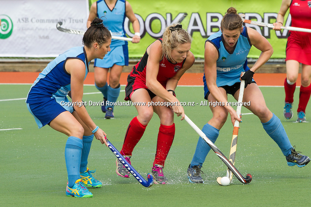 Canterbury`s Sophie Cocks and Northland`s Brooke Neal challenge for the ball in the Canterbury v Northern Women`s semi-final match, Ford National Hockey League, North Harbour Hockey Stadium, Auckland, New Zealand,Saturday, September 13, 2014. Photo: David Rowland/Photosport