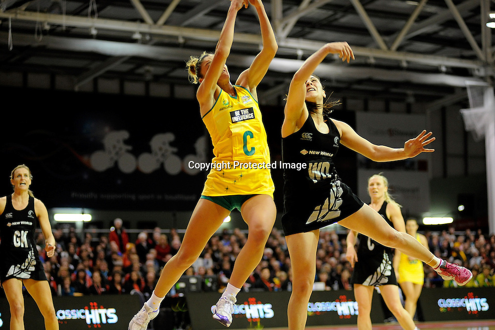 Kim Green of the Diamonds and Silver Ferns Joline Henry contest for the ball. Constellation cup netball. Silver Ferns v Australian Diamonds at ILT Velodrome, Invercargill, New Zealand. Sunday 15th september 2013. New Zealand. Photo: Richard Hood/photosport.co.nz