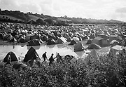 View of hundreds of tents in a flooded camp site, Glastonbury 2005