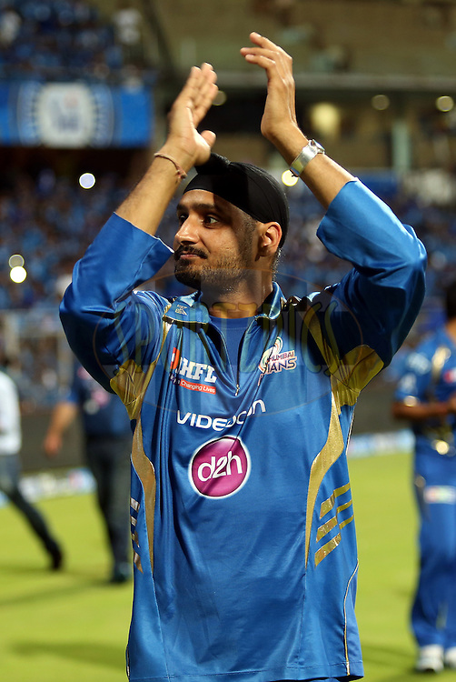 Harbhajan Singh of the Mumbai Indians Takes a lap of the ground after the match 22 of the Pepsi Indian Premier League Season 2014 between the Mumbai Indians and the Kings XI Punjab held at the Wankhede Cricket Stadium, Mumbai, India on the 3rd May  2014<br /> <br /> Photo by Sandeep Shetty / IPL / SPORTZPICS<br /> <br /> <br /> <br /> Image use subject to terms and conditions which can be found here:  http://sportzpics.photoshelter.com/gallery/Pepsi-IPL-Image-terms-and-conditions/G00004VW1IVJ.gB0/C0000TScjhBM6ikg