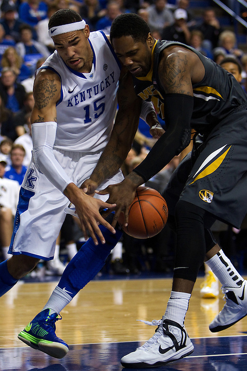 UK forward Willie Cauley-Stein, left, fights for a loose val with Missouri forward Alex Oriakhi in the first half. The University of Kentucky Men's Basketball team hosted Missouri , Saturday, Feb. 23, 2013 at Rupp Arena in Lexington .