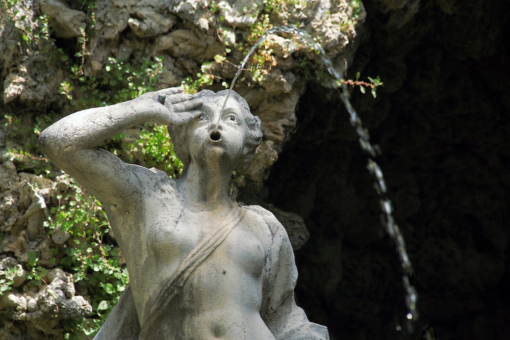 Trsteno: fountain of Neptune in the garden of the Gucetic family summer house.  Fountain and sculpture date from 1736. Female figure shoots water from her mouth.