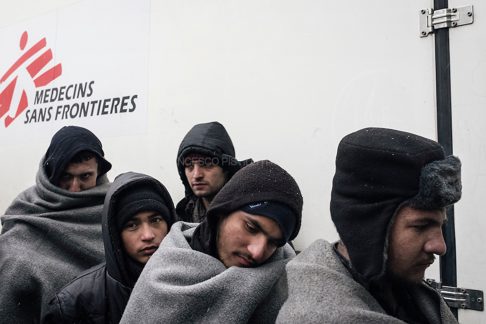 Afghan refugees line up waiting for medical screenings by MSF (Doctors without borders).