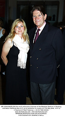 MR JOHN MADEJSKI the multi millionaire chairman of the Madejski Stadium in Reading and MISS THERESA HALLETT, at an exhibition in London on 11th May 2004.PTY 13