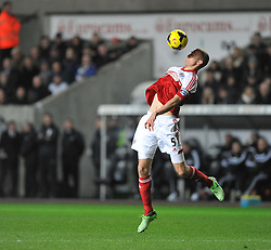 Fulham's Brede Hangeland controls the ball. - Photo mandatory by-line: Alex James/JMP - Tel: Mobile: 07966 386802 28/01/2014 - SPORT - FOOTBALL - Liberty Stadium - Swansea - Swansea City v Fulham - Barclays Premier League