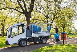 A worker in Roundwood Park, North West London loads rubbish bags into his truck following the hottest May bank holiday weekend on record, park workers have their work cut out creating up the mess left behind by picnickers. London, May 08 2018.