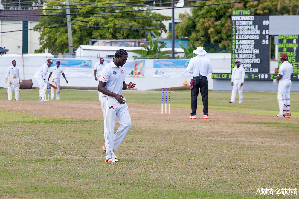 7759: Leeward Islands Hurricanes fast-medium bowler Gavin Tonge examines the ball as he prepares to bowl against Windward Islands Volcanoes on the third day of the seventh round match in the WICB Professional Cricket League Regional 4-Day Tournament on Sunday, February 21, 2016 at the Addelita Cancryn Junior High School.<br /> <br /> &copy; Aisha-Zakiya Boyd