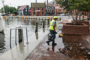 """Annapolis, Maryland - June 05, 2016: Norman Dorsey, public works employee with the City of Annapolis, cleans up detritus left after a perigean spring tide flooded the Kunta Kinte-Alex Haley Memorial park located at the City Dock in historic Annapolis early Sunday morning June 5th, 2016.  <br /> <br /> <br /> A perigean spring tide brings nuisance flooding to Annapolis, Md. These phenomena -- colloquially know as a """"King Tides"""" -- happen three to four times a year and create the highest tides for coastal areas, except when storms aren't a factor. Annapolis is extremely susceptible to nuisance flooding anyway, but the amount of nuisance flooding has skyrocketed in the last ten years. Scientists point to climate change for this uptick. <br /> <br /> <br /> CREDIT: Matt Roth for The New York Times<br /> Assignment ID: 30191272A"""