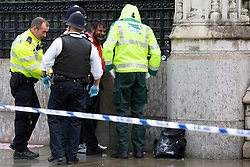 © Licensed to London News Pictures. 01/10/2019. London, UK. Police detain a man who poured petrol on himself and attempted to set himself on fire outside the Houses of Parliament at Carriage Gate. Photo credit: George Cracknell Wright/LNP