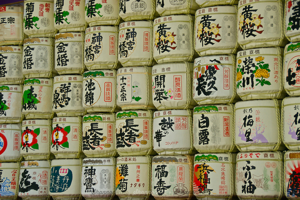 Traditional sake casks or barrels displayed at Meiji Jingu Gyoen (Meiji Shrine Park), Harajuku, Tokyo, Japan.