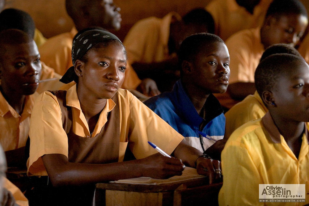 A girl is surrounded by an overwhelming majority of male students during class at the Savelugu Junior Secondary School in Savelugu, Ghana on Tuesday June 5, 2007.
