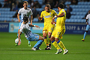 Coventry City defender Lewis Page (15) \and AFC Wimbledon midfielder Dean Parrett (18) tussle during the EFL Sky Bet League 1 match between Coventry City and AFC Wimbledon at the Ricoh Arena, Coventry, England on 28 September 2016. Photo by Stuart Butcher.