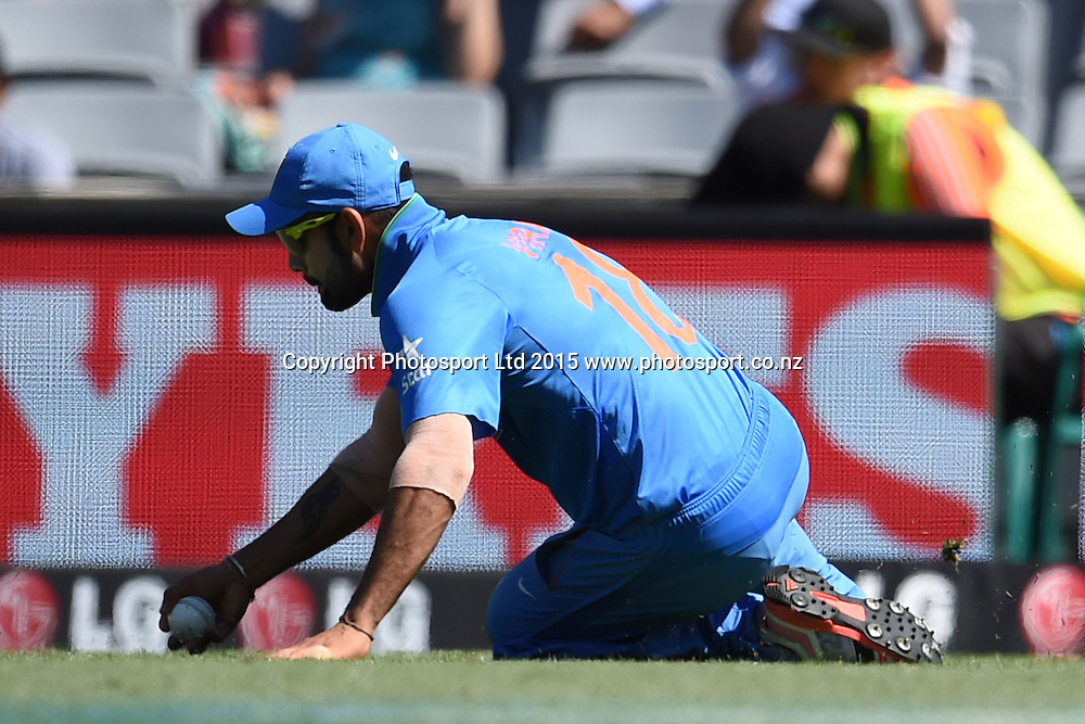 Indian fielder Virat Kohli in action during the ICC Cricket World Cup match between India and Zimbabwe at Eden Park in Auckland, New Zealand. Saturday 14 March 2015. Copyright Photo: Raghavan Venugopal / www.photosport.co.nz