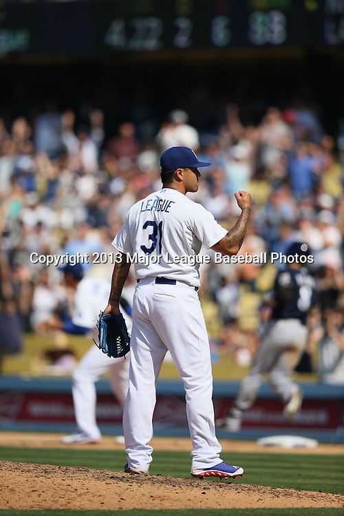 LOS ANGELES, CA - APRIL 28:  Brandon League #31 of the Los Angeles Dodgers pumps his fist in celebration after closing the game against the Milwaukee Brewers on Sunday, April 28, 2013 at Dodger Stadium in Los Angeles, California. The Dodgers won the game 2-0. (Photo by Paul Spinelli/MLB Photos via Getty Images) *** Local Caption *** Brandon League