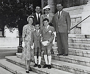 young boys with there parents posing to commemorate their holy communion, 1952 France
