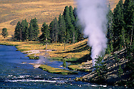 Steam venting from gesyer on bank of Yellowstone River, Mud Volcano area, Yellowstone National Park, WYOMING