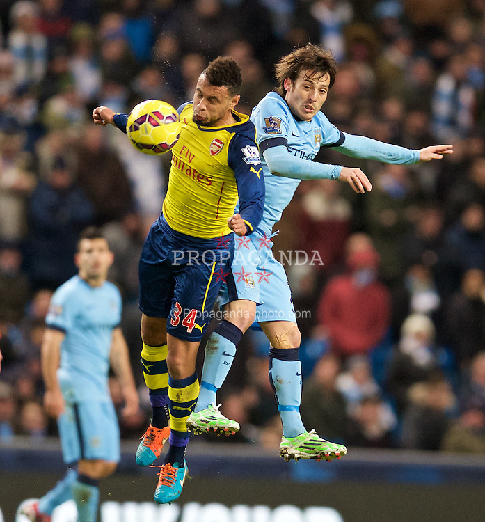 MANCHESTER, ENGLAND - Sunday, January 18, 2015: Manchester City's David Silva in action against Arsenal's Francis Coquelin during the Premier League match at the City of Manchester Stadium. (Pic by David Rawcliffe/Propaganda)
