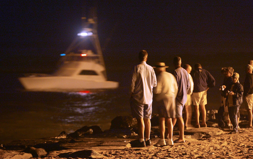 (SPORTS)  8/6/2003  The parade of boats leaving the Ocean City Inlet along with several hundred spectators along the shore on day 3 of fishing in the White Marlin Open Tournament.   Michael J. Treola Staff Photographer...MJT