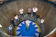 DEU, Germany, Duesseldorf, fun fair at the banks of the river Rhine in the town district Oberkassel, visitors in the ride Rotor [the Rotor is a large rotating drum where the visitors are standing with their backs to the wall. When the rotation of the drum is fast enough the floor drives down. By the centrifugal force the visitor cleaves at the wall, the centrifugal force defeats the gravitation force].<br /> <br /> DEU, Deutschland, Duesseldorf, Kirmes auf den Rheinwiesen im Stadtteil Oberkassel, Besucher im Fahrgeschaeft Rotor der Schaustellerfamilie Pluschies [der Rotor ist eine grosse sich drehende Trommel, bei der der Besucher sich mit dem Ruecken zur Wand stellt. Dreht sich die Trommel schnell genug, wird der Boden nach unten gefahren. Der Besucher klebt durch die Fliehkraft an der Wand, die Fliehkraft siegt ueber die Schwerkraft] .