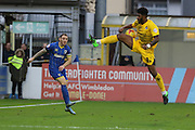 Ollie Clarke of Bristol Rovers blocks Barry Fuller (Captain) of AFC Wimbledon cross  during the Sky Bet League 2 match between AFC Wimbledon and Bristol Rovers at the Cherry Red Records Stadium, Kingston, England on 26 December 2015. Photo by Stuart Butcher.