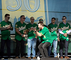 Returning second baseman Jed Lowrie (8) gets excited about his teammates during introductions at Oakland Athletics FanFest at Jack London Square on Saturday, Jan. 27, 2018 in Oakland, Calif. (D. Ross Cameron/SF Chronicle)