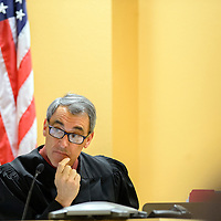 033114  Adron Gardner<br /> <br /> Judge Louis DePauli listens as attorney Pat Rogers addresses the court at the McKinley County Courthouse in Gallup Monday.