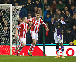 STOKE-ON-TRENT, ENGLAND - Sunday, January 12, 2014: Stoke City's Charlie Adam celebrates scoring the second goal against Liverpool during the Premiership match at the Britannia Stadium. (Pic by David Rawcliffe/Propaganda)