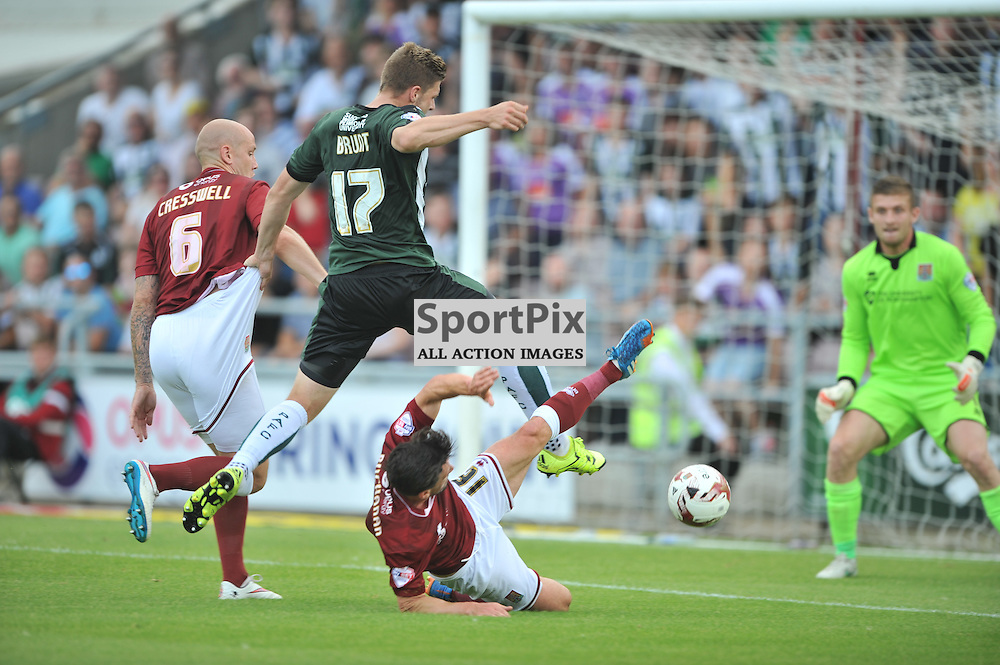Northmaptons Dfence bring down plymouths Ryan Brunt in the Penalty Area, which Plymouth Manager and Players demanded a Penalty But Referee Declined, Northampton Town v Plymouth Argyle, Sky Bet League 2, Saturday 22/8/2015