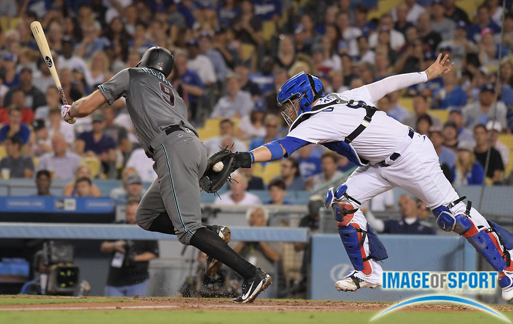Sep 5, 2017; Los Angeles, CA, USA; Arizona Diamondbacks first baseman Adam Rosales (left) is tagged out by Los Angeles Dodgers catcher Yasmani Grandal after striking out in the fourth inning during a MLB baseball game at Dodger Stadium.