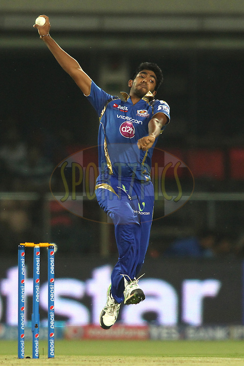 Jasprit Bumrah of Mumbai Indians sends down a delivery during match 21 of the Pepsi IPL 2015 (Indian Premier League) between The Delhi Daredevils and The Mumbai Indians held at the Ferozeshah Kotla stadium in Delhi, India on the 23rd April 2015.<br /> <br /> Photo by:  Shaun Roy / SPORTZPICS / IPL