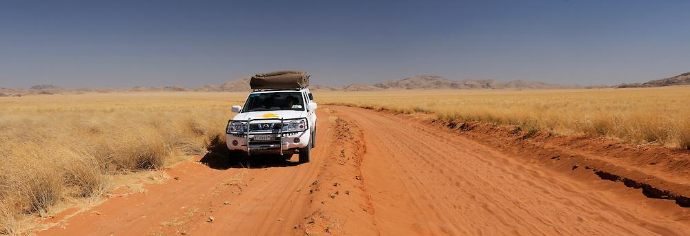 KEA 4x4 camper on Sand road near Palmwag, Kaokoland, Kunene Region, Namibia...