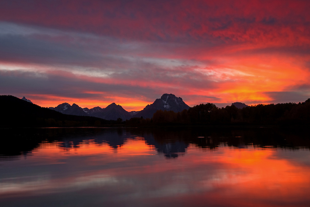 A brilliant sunset lights up the night at Oxbow Bend in Grand Teton National Park.