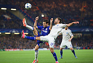 Cesc Fabregas of Chelsea and Serhiy Rybalka of Dynamo Kyiv during the UEFA Champions League match at Stamford Bridge, London<br /> Picture by Alan Stanford/Focus Images Ltd +44 7915 056117<br /> 04/11/2015