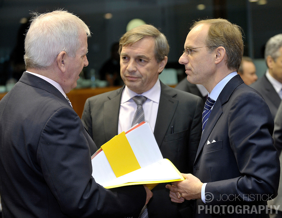 Charlie McCreevy, the EU's financial-services commissioner, left, speaks with Jeannot  Krecke, Luxembourg's minister of economy and foreign trade, center, and Luc Frieden, Luxembourg's minister of Finance, right, during ECOFIN, the meeting of EU finance ministers, at the European Council headquarters in Brussels, Belgium, on Tuesday, Nov. 10, 2009. (Photo © Jock Fistick)