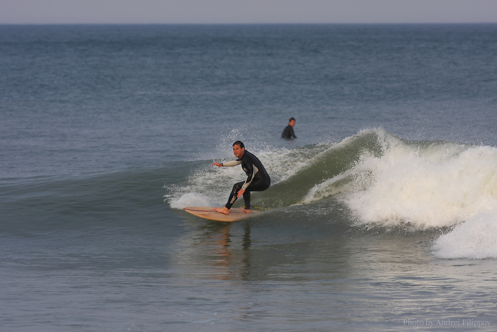 Surfers at the Marconi Beach, Cape Cod, Massachusetts, USA, September 3, 2011.