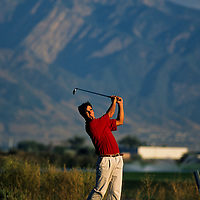 Golfer teeing off at Wingpointe Golf Course, Utah