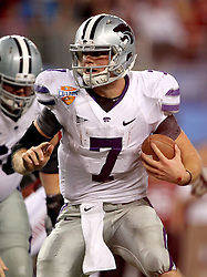 Kansas State quarterback Collin Klein (7) in action during the 2012 AT&T Cotton Bowl game between Arkansas and Kansas State at Cowboy Stadium in Arlington, Tx. on Jan 6th, 2012.