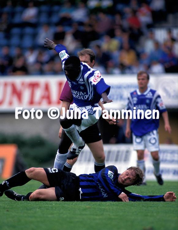 14.06.1997, Kupittaa Stadium, Turku, Finland..Veikkausliiga, Inter Turku v Rovaniemen Palloseura.Erkka Pet?j? (Inter) v Zeddy Saileti (RoPS).©Juha Tamminen