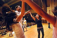 "USA, Chicago, July 2nd - 23rd, 2009.  For almost 20 years, Polo Garcia, a professional dance teacher from ""America Baila,"" has been giving traditional South American dance lessons at various Pilsen and Little Village schools, including Maria Saucedo Scholastic Academy, whose turn-of-the-century auditorium is featured here. Garcia, who is Mexican, does the research for these dances in-person, makes the costumes himself, and provides free summer classes. He works with Claudio Rabadan, a former Saucedo student, and professional instructor Ruben Pachas from Peru. Photographs for HOY by Jay Dunn."